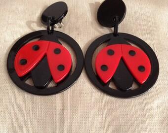 """1980's """"lady bug"""" earrings."""