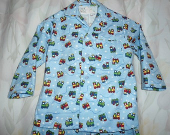 Size 2 Boys Pajamas with trains on blue background
