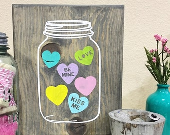 Mason jar with conversation hearts sign