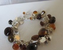 Vintage Bracelet, Signed LC, Liz Clairborne, Brown Glass Beads, Silver Bracelet, Multi Sized Glass Beads, Flat Circles, Collectible Jewelry