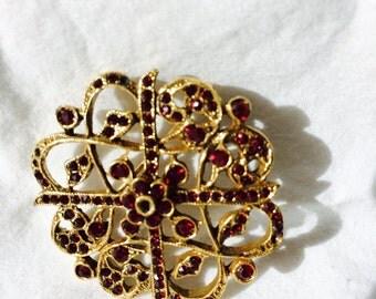 Vintage round pin with garnets