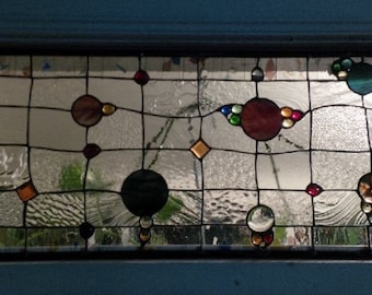 colourful, orbital, whimsical,  stained glass transom