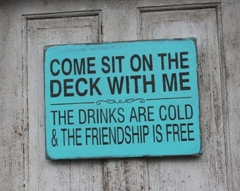 Come sit on the DECK with me, the drinks are cold and the friendship is free wood sign