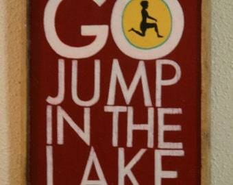 """Hand made hand painted  wood sign """"Go jump in the lake""""  lake house cabin sign recycled wood wall art wall hanging  wood sign"""