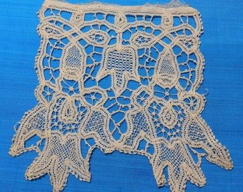An antique needlelace bodice piece