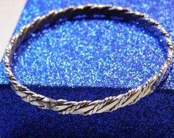 Avon Woven Chain Silver Tone Metal Bracelet-Hallmark Avon inside bracelet