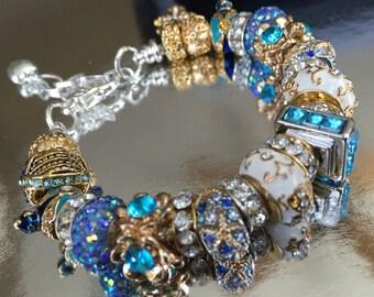 Gold and blue charm bracelet.