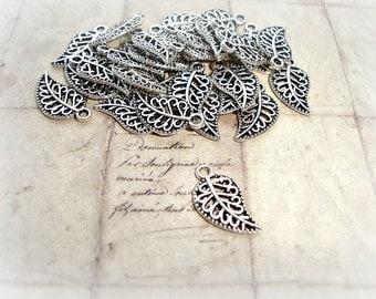 10 Tibetan Silver Leaf Charms Filigree Carved