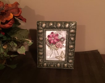 Lovely framed pink jewelry flowers