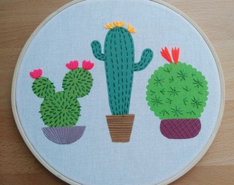 Three cacti embroidery hoop art. Colourful contemporary hand stitched design