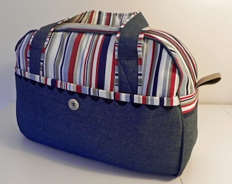 A spacious holdall weekender with zip fastening and front pocket