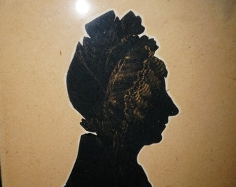 """Early cut out silhouette E. Whittley 1833. 3 1/4"""" wide by 4 1/2"""" tall."""