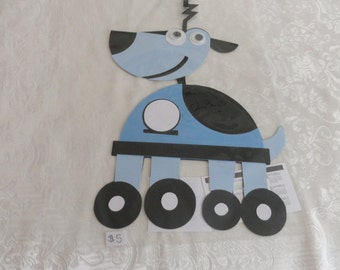 novelty  dog on wheels wall hanging