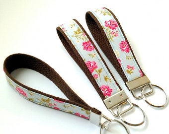 Rose Bouquet On Blue ONE Key Fob / Brown Webbing