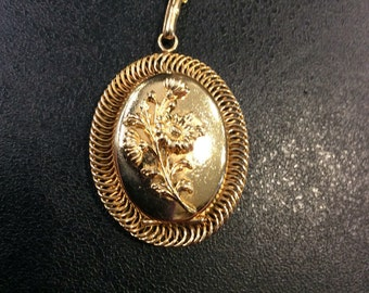 Gold locket with flowers on chain