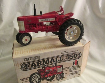 Farmall 350 toy tractor Ertl # 418  1:16 scale model red diecast metal,  new in original box, vintage 1982
