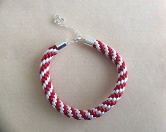 Red and white kumihimo bracelet