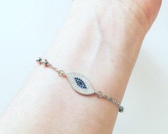 Bracelet with evil eye in brass with zirconia