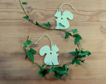 Set of two medium sized ceramic squirrels ornament in white clay with lace pattern.