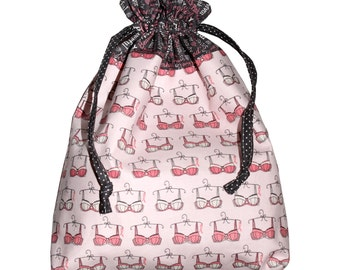 Cloth bag-laundry on pink Bras