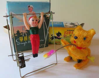 Vintage Wind Up Plush on Tin Cat and Celluloid Boy on Exercise Bar