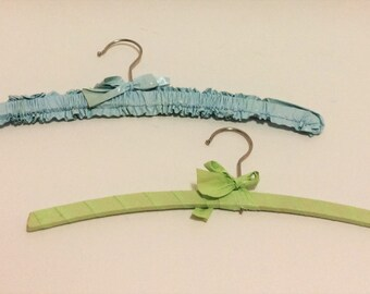 vintage wooden hangers for children plastic covered cloth hangers green and blue