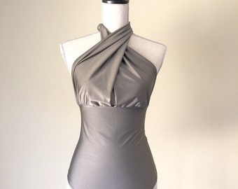 One piece swimsuit on solid gray spandex.