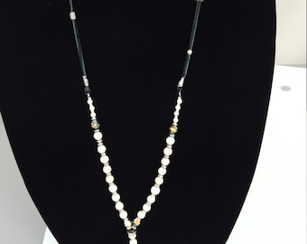 White beaded tooth necklace