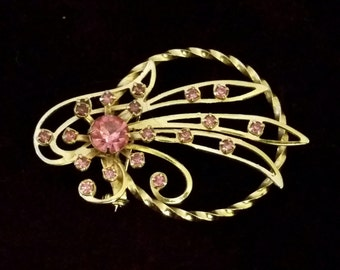 Lovely and unique, 50's, gold tone, brooch with bright pink rhinestones!