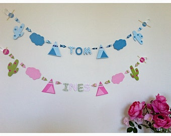 paper garland with first name, moon, hotair balloon, planes and sparkling stars