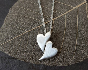 Fine silver elongated hearts pendant