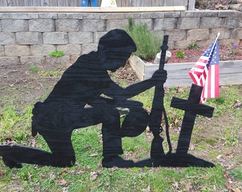 Yard shadow art silhouette Soldier praying at cross