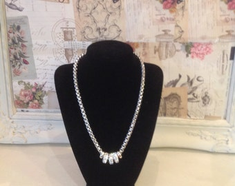 White gold finished necklace with diamante ring detail