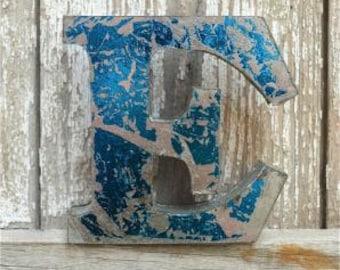 A fantastic vintage style metal 3D blue letter E