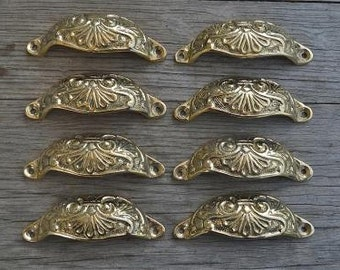 A set of 8 brass Victorian style cup drawer handles c/w screws 2003