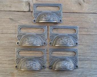 A set of 5 large Edwardian cast iron label frame handles CB10