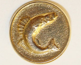 Vintage gold metal button imprinted with fish design.