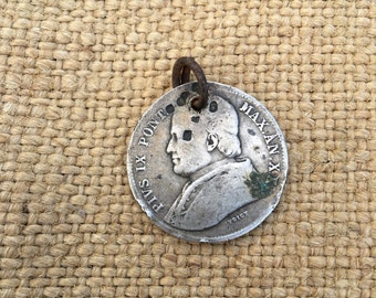 Vintage 1863 coin with the pope
