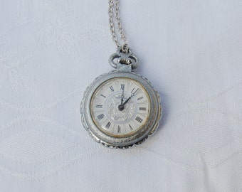 Fine Vintage Pocket Watch Pendant on long Silver coloured Chain.