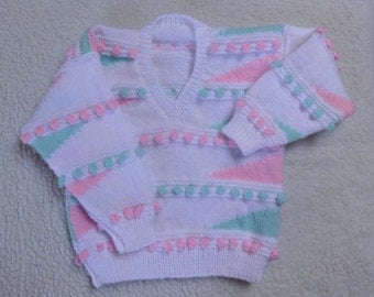 Girls Sweater Size 29 inch chest approx  3  to 4 years. Hand knitted in Multi colour DK yarn.