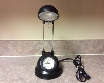 A Portable Halogen Lamp with a Quartz Clock.