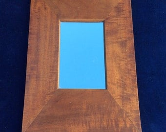 Small accent mirror with lovely wood frame
