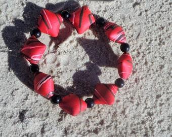 pink lined red suede bracelet