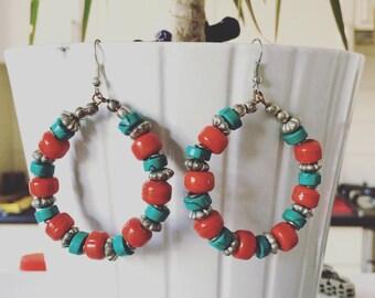 Tibetan style glass bead and metal hoop earrings.