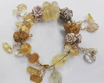 Citrine Charm Bracelet: Best for attracting abundance, prosperity, in career and business
