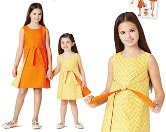 Girls' Jiffy Reversible Wrap Dress. Size 3-6 and 7-14. Simplicity 8104. Pattern is new and uncut.