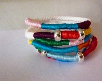 Colourful yarn bracelets with silver accents