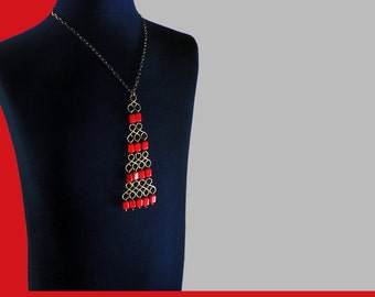 vintage Sixties pendant with red beads on chain.