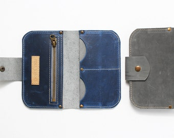 Grey leather wallet with blue insides