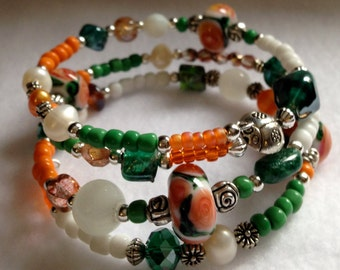 Spring Garden Memory Wire Wrap Bracelet with Orange, Green & White Glass Beads Floral design and Lady Bug Bead